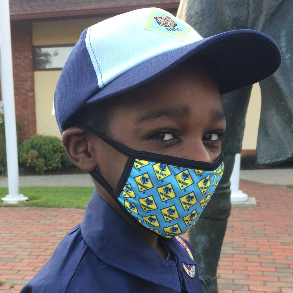 Cub Scout models face mask with Cub logo