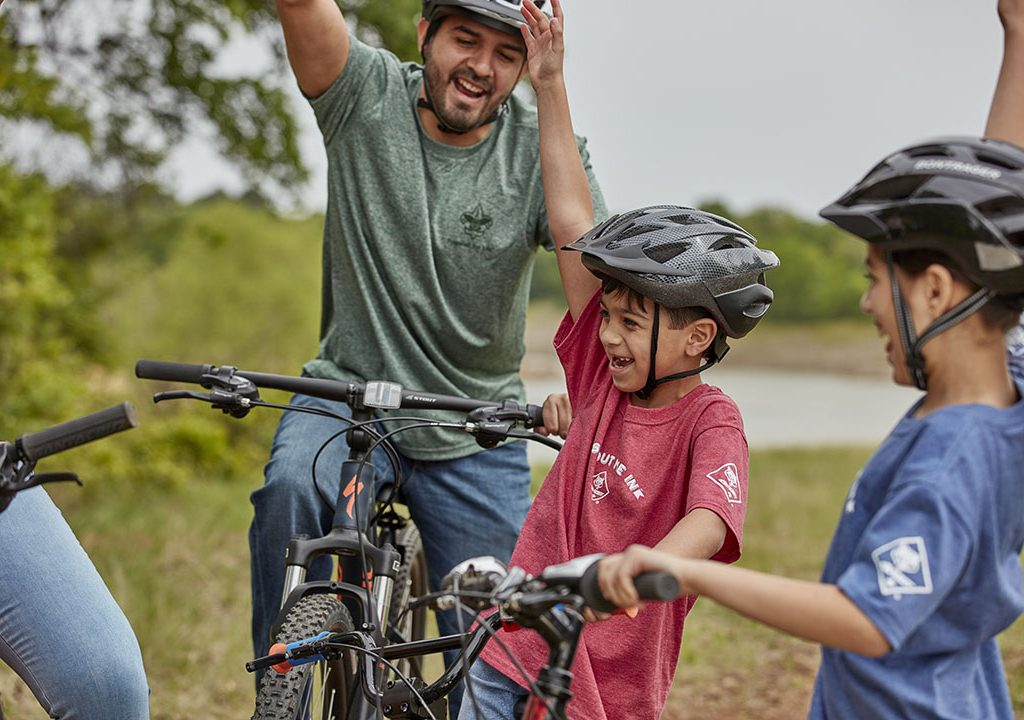 Cub Scouts and adult volunteers enjoy a bike outing