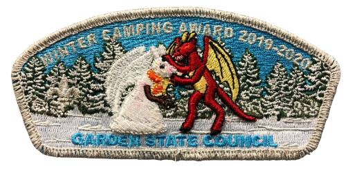 Garden State Council Winter Camper Award Council shoulder patch for 2020 features the Jersey Devil making a snowman of himself with snowy pine trees in the background